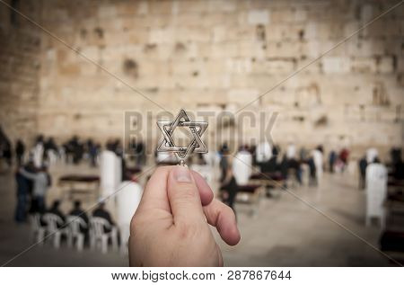 Jerusalem, Israel. February 15, 2019. Hand Holding A Star Of David, A Jewish National And Religious