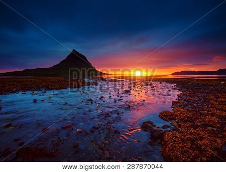 Great sunset over the Atlantic ocean. Location place Kirkjufell volcano the coast of Snaefellsnes peninsula, Iceland, Europe. Dramatic image of beautiful nature landscape. Explore the beauty of earth.