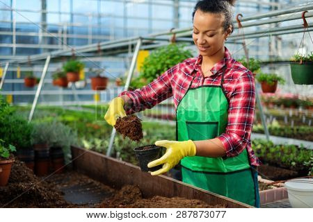 Black woman working in a botanical garden