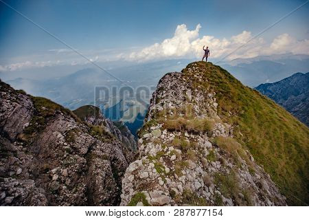 A Man On The Mountain Peak. Man Makes Selfie In Top Of Mountain.