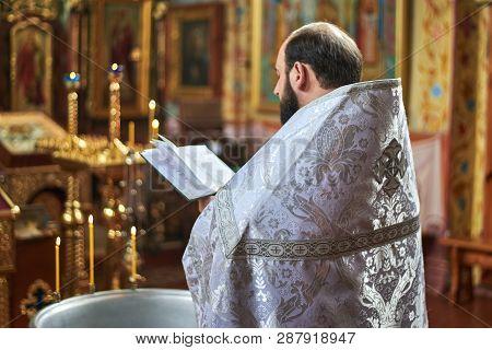 Ukraine,shostka, Vladimirskaya Church -march 3, 2019: The Priest Performs The Rite Of The Sacrament