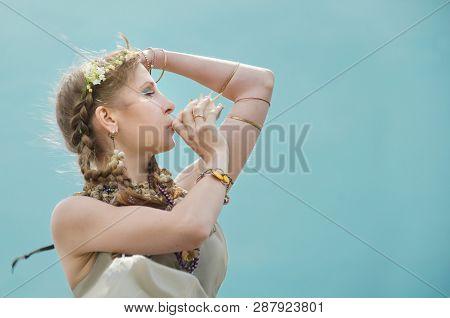 Portrait Of A Mermaid Blowing A Seashell