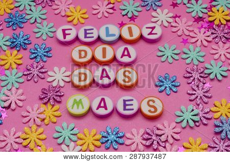 Feliz Dia Das Mães Made From Colorful Letters And Little Colorful Flowers Against Pink Background