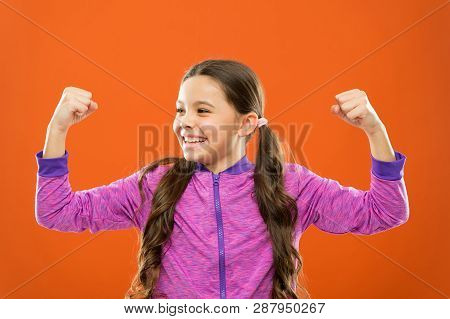 Feeling Strong. Child Cute Girl Show Biceps Power And Strength. Girls Rules Concept. Upbringing Advi