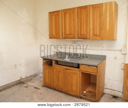 An Outdated Kitchen In Need Of Repair