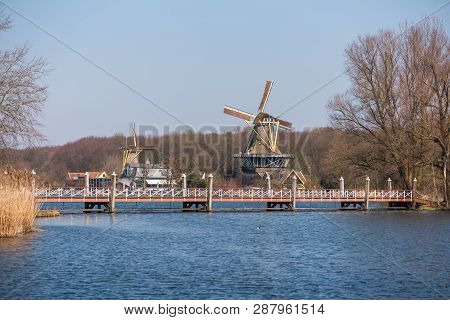 Rotterdam, Netherlands - March 17, 2016: Windmill With Lake And A Bridge At Kralingse Bos In Rotterd
