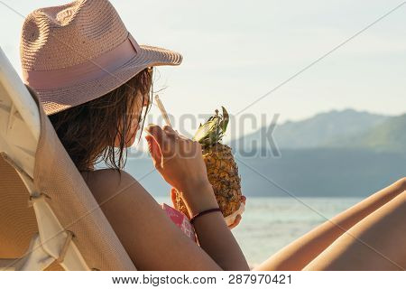 Traveler Girl Relaxing On The Beach. Young Girl Traveler Relaxing In Vacation. Traveler Relaxing On