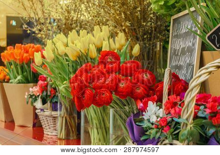 Flower shop concept. Close-up beautiful lovely bouquet of mixed flowers on wooden table. Flowers composition. Abstract background of flowers.