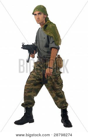 Man In Camouflage With Gun.