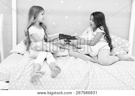 Sisters rivalry concept. Sisters relations issues. Share book with friend. Children in bedroom want read evening fairy tale. This is my book. Girlish rivalry. She dont want to share her book. poster