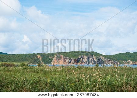 View Of Summer Sky, Hills And Marsh Near Stark Strait, Russia. Nature And Tourism Theme.