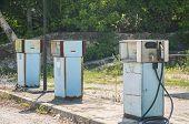 Old abandoned vintage obsolete petrol fuel gas dispenser in former petrol station poster
