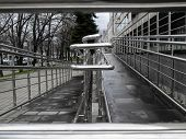 Handrail for rise on a wheelchair. Brilliant hand-rail from stainless steel. Wet surface poster