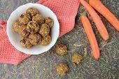 Healthy vegan carrot date chia hemp seed oat energy balls or bliss balls poster