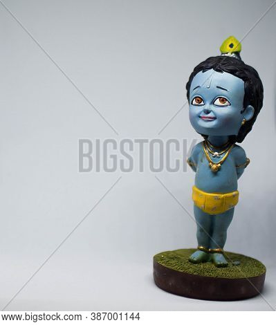 Cute And Innocent Idol Of Hindu God Lord Krishna As A Child With White Background And Right Oriented