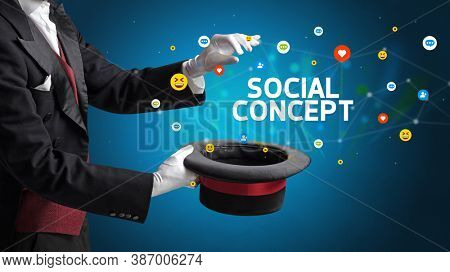 Magician is showing magic trick with SOCIAL CONCEPT inscription, social media marketing concept