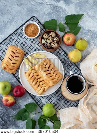 Top View Food Photography. Baked Puff Pastry Crispy Apple Puff With Ingredients And Cup Of Coffee On