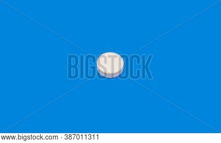 White Pill On Blue Background. Bright Pill On Indigo Background. White Seamless Pattern And Green Pi