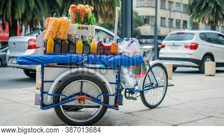 Mexican Cargo Bike Full Of Fried Snacks And Slush Syrup Bottles In The Streets Of Mexico City