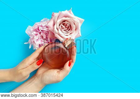 Top View And Close-up Of Bottle Of Perfume, Caucasian Female Hand With Red Nails And Pink Flowers On