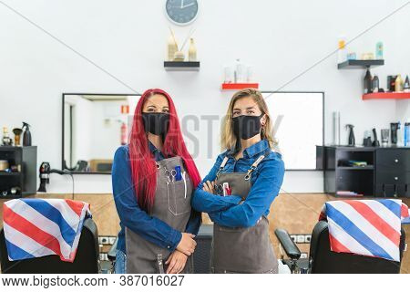 Two Barber Women Wearing Mask At The Barbershop Looking .