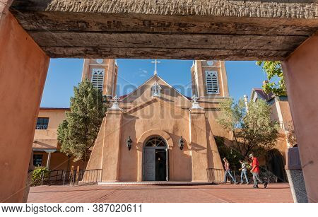 Albuquerque Usa September 17 201s; People Walk By San Felipe De Neri Church In Spanish Architectural