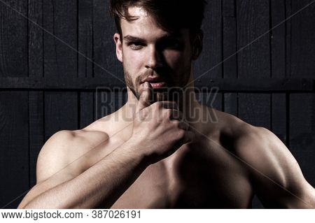 Studio Shot Of Young Man Looking At The Camera. Handsome Guy With Confident Face. Mens Sexuality Or