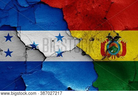 Flags Of Honduras And Bolivia Painted On Cracked Wall