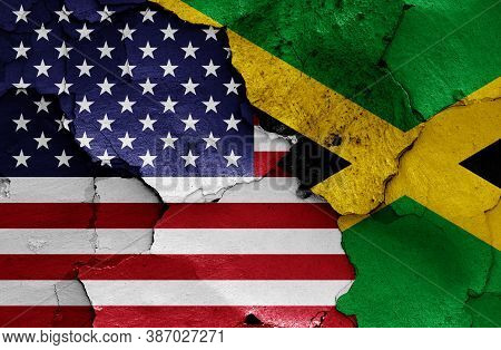 Flags Of Usa And Jamaica Painted On Cracked Wall