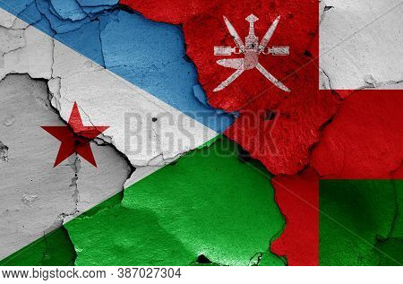 Flags Of Djibouti And Oman Painted On Cracked Wall