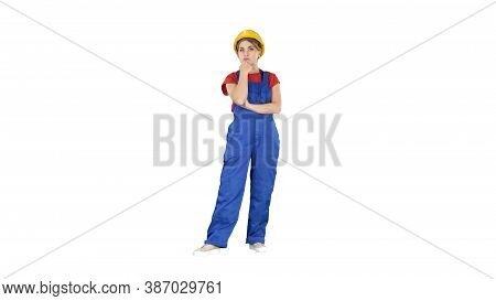 Woman In Construction Uniform Listening To Instructions On White