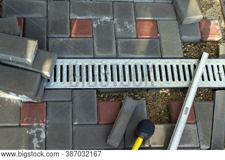 Gutter, Gutter, Drain For Water After Rain On The Sidewalk. Installation Of Paving Slabs And Drainag