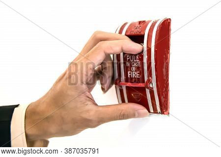 Close-up Hand Is Pulling The Emergency Switch In Case Of Fire For Exit Door Release And Turn On The