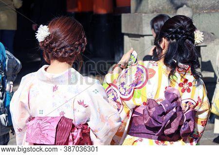 Fushimi-ku, Kyoto, Japan, November 17, 2017 : Behind Of Two Japanese Woman In Kimono Dress At Fushim