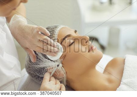 Cosmetologist Wiping Skin With Cotton Pads During Facial Beauty Botox Injection For Young Womans Che