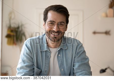 Headshot Of Smiling Man Talk On Video Call At Home