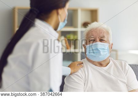 Woman Doctor Visits The Elderly Man And Provides Him With Support During The Quarantine.
