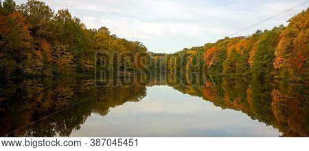 Early Morning On The Lake Surrounded By Autumn Trees