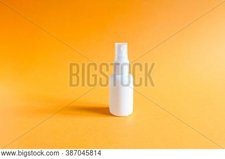 Mockup Of Unbranded White Plastic Spray Bottle On A Textured Bright Orange Background. Natural Organ