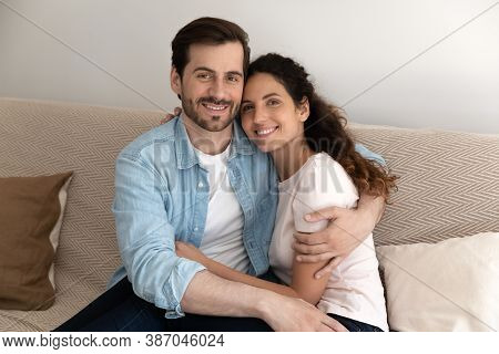 Portrait Of Happy Couple Renters Relax In New Home