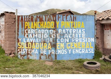 Ccorao, Peru - April 4, 2014: The Rusty Doors Of An Old Car Workshop On The Road Towards Taray And P