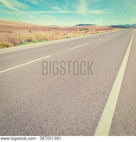 Asphalt Road In The Cantabrian Mountains, Spain, Vintage Style Toned Picture