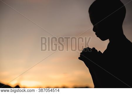 A Little Prayer, A Boy Is Praying Seriously And Hopefully To Jesus, Pay Respect Prayer Concept For F