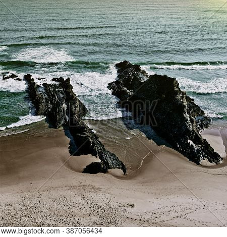 Rocky Coast Of Atlantic Ocean In Portugal At Sunset, Vintage Style Toned Picture