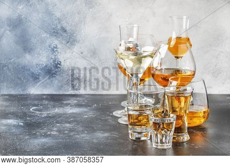 Selection Of Hard Strong Alcoholic Drinks In Big Glasses And Small Shot Glass In Assortent: Vodka, C