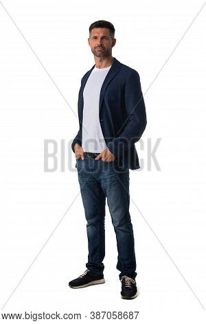 Full Length Portrait Of Mid Adult Serious Business Man In Jeans And Blue Blazer Isolated On White Ba