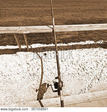 Fishing Rod On The Promenade Of The Old Port In Tel Aviv, Vintage Style Sepia