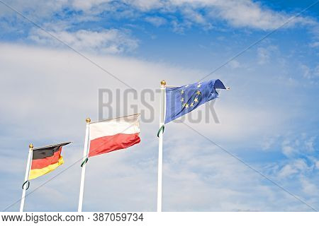 Flag Of Germany, Poland  And The European Union. Politics, Social Equality And Economy Concept