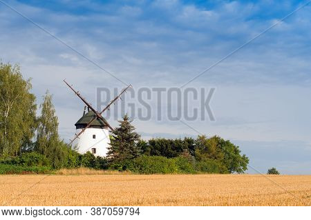 A Windmill Farm Scene In Autumn. Close Up