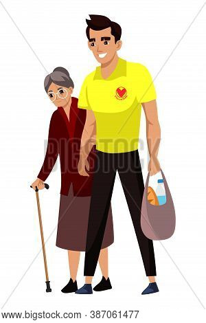 Man Volunteer Help Senior Woman With Purchase, Cross Road And Go Home. Guy Carrying Shopping Paper P